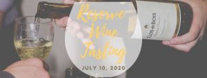 white wine falls into a tasting glass